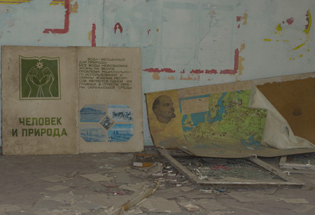 PRIPYAT, UKRAINE - JUNE 25, 2017: Abandoned Room In Ghost Town of Chernobyl Within Chernobyl Alienation Zone. Text on book, Man and nature. Life is impossible without water. Saving of water resources is the main task.