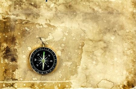 Compass on old vintage grunge paper background