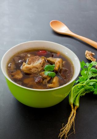Top view, stew of pork and herbal soup, ba kut teh on black backgroud