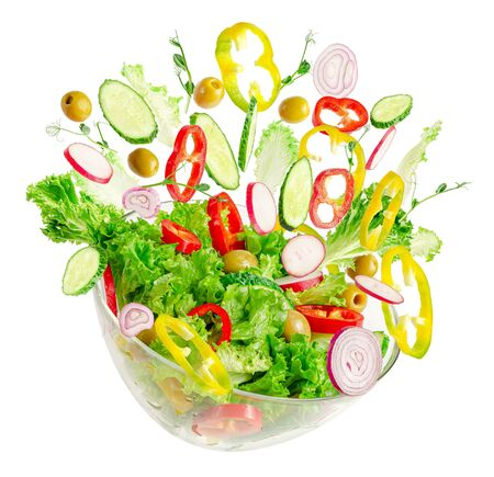 Photo for Fresh vegetable salad in transparent bowl with flying ingredients isolated on white. Proper nutrition. - Royalty Free Image
