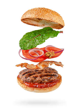 Photo for Flying hamburger with clipping path isolated on white background. Fast food - Royalty Free Image