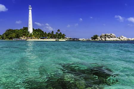 Foto de View of Lengkuas Island with white lighthouse / Belitung-Indonesia / - Imagen libre de derechos
