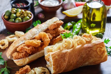 Foto de sandwiches with calamari ringss, Bocadillos De Calamares, fresh bread roll filled with squid rings that have been coated in flour and in breadcrumbs and deep-fried in olive oil, spanish cuisine - Imagen libre de derechos