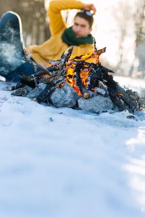 Burning firewood, bonfire macro photo with selective focus.