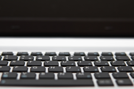Modern laptop keyboard and monitor with shallow dof