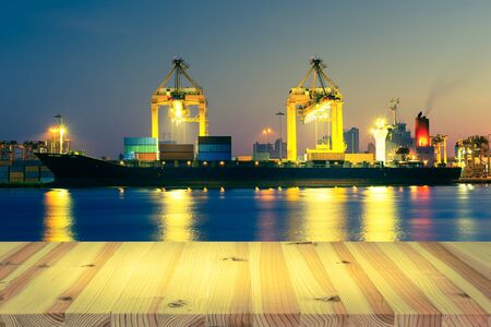 Photo for Cargo ship and crane at port, twilight time. - Royalty Free Image