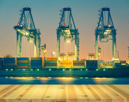 Photo for Cargo ship unloading container at port,  twilight time. - Royalty Free Image