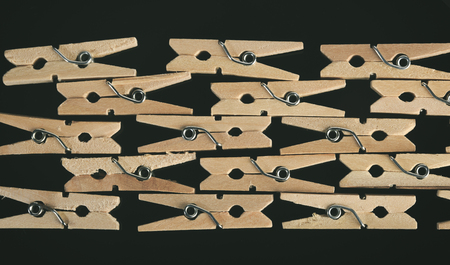 Group of wooden clothes pin in black background
