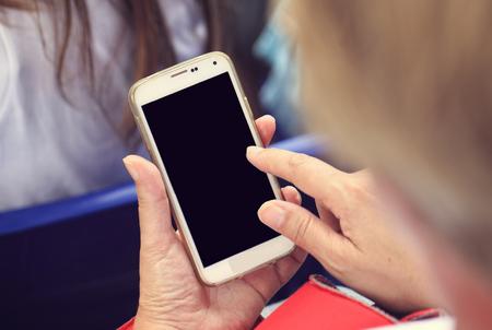 woman looking her smart phone