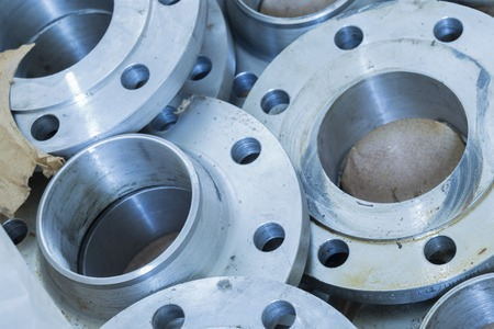 Photo pour Flanges stacked in warehouse, selective focused - image libre de droit