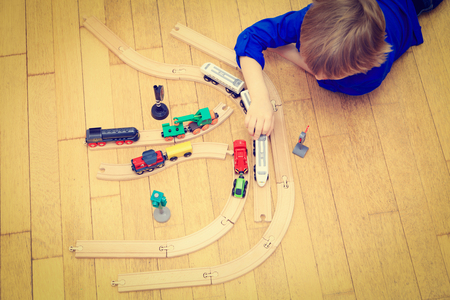 child playing with trains indoor, early learning
