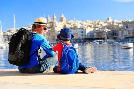 Foto de father and son looking at city of Valetta, Malta, family travel - Imagen libre de derechos
