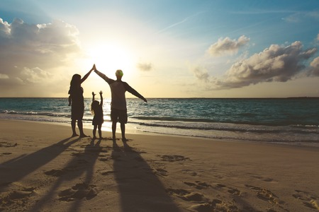 Photo pour happy family with kids play at sunset beach - image libre de droit