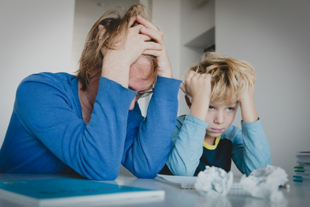 Photo pour father tired of doing homework with son, difficult learning - image libre de droit