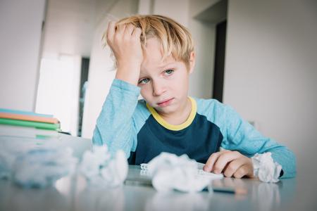 Photo pour little boy tired stressed of reading, doing homework - image libre de droit