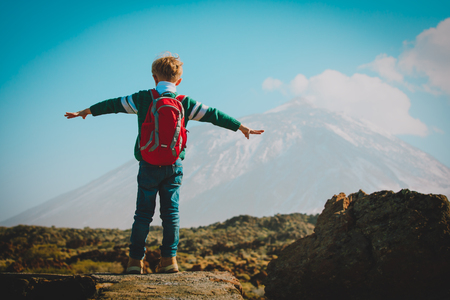 Photo for happy boy hiking in mountains, family travel - Royalty Free Image