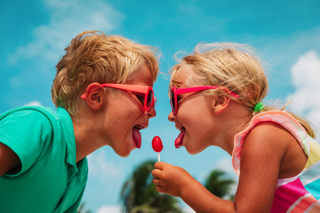 Photo for happy little girl and boy with lollipop on summer vacation - Royalty Free Image