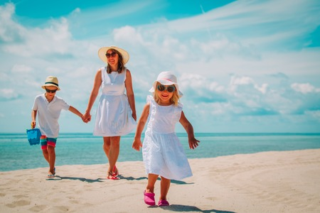 Photo for mother with son and daughter walk on beach - Royalty Free Image