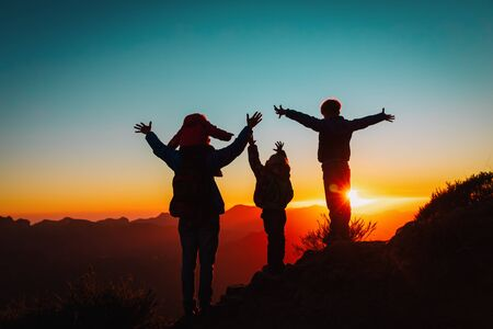 Photo for happy family with kids travel in sunset mountains, silhouette of family enjoy hiking - Royalty Free Image