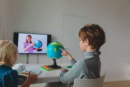Foto für Kids learning remotely. Children having online lesson at home - Lizenzfreies Bild