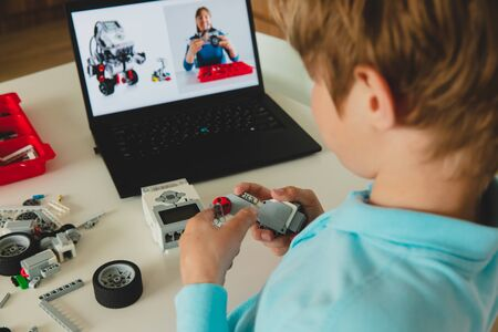 Photo for kid building robot with online robotic technology lesson - Royalty Free Image