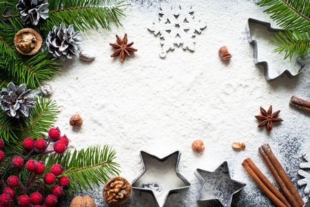 Photo for Ingredients for christmas baking - flour, spices and cookie cutters. - Royalty Free Image