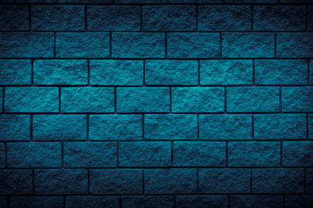 dark blue brick stone texture background. Free space for design. Blue wall background. Vignette.