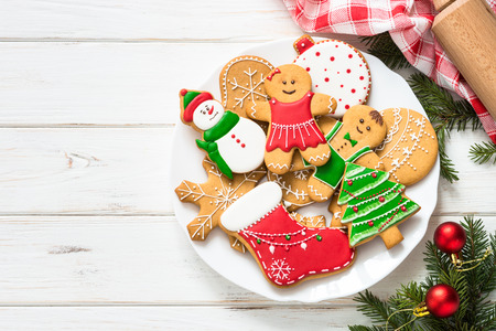 Photo for Christmas gingerbread on white wooden background. Christmas cooking baking background. Top view with copy space. - Royalty Free Image