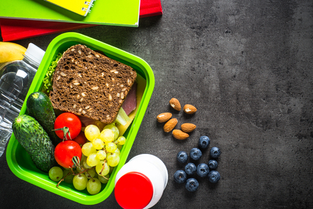 Photo for Lunch box with sandwich, fruit, vegetables, water. - Royalty Free Image