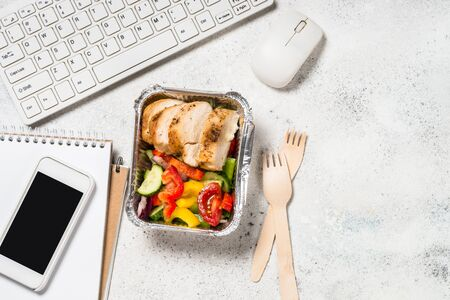 Foto de Food delivery concept - lunch box on office table. - Imagen libre de derechos