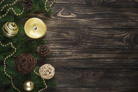 Foto de Christmas background with candle and decorations on dark wooden table. - Imagen libre de derechos