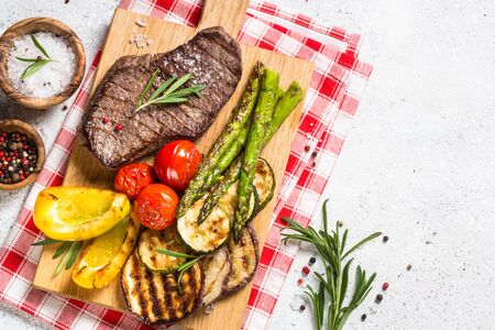 Photo for Grilled meat with vegetables on white stone table. - Royalty Free Image