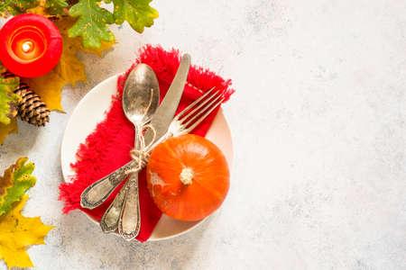 Foto de Autumn table setting top view at white table. - Imagen libre de derechos