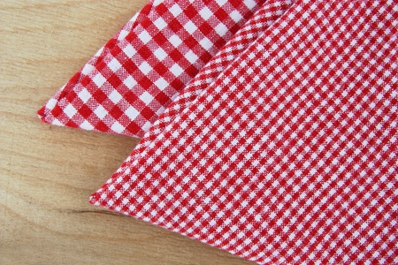 checkered napkins on wooden table