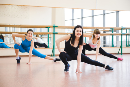 Photo for Group of people at the gym in a stretching class - Royalty Free Image