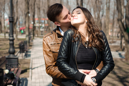 Photo for Portrait of young couple in love in a park - Royalty Free Image