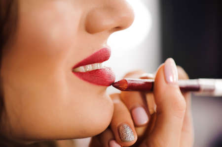 Photo pour Red Lipstick. Closeup Of Woman Face With Bright Red Matte Lipstick On Full Lips. Beauty Cosmetics, Makeup Concept. High Resolution Image - image libre de droit