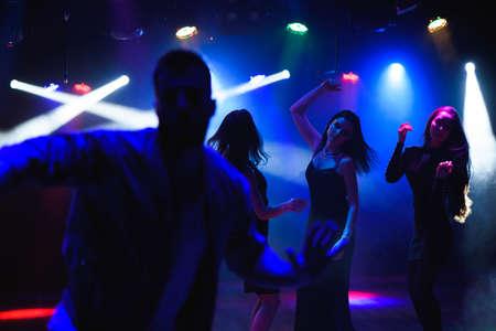 Photo pour Group of friends at a club having fun. - image libre de droit