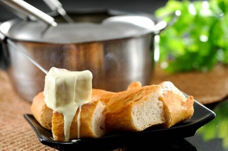 Dipping into a cheese fondue