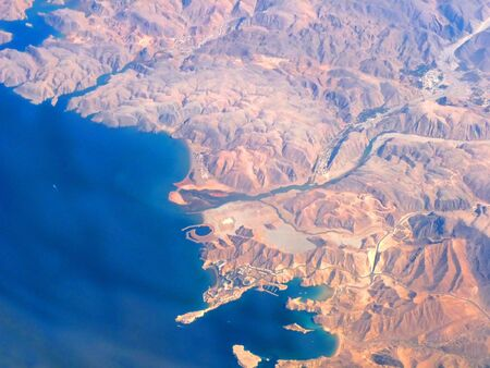 Aerial View of Oman Coastline taken from 35000 ft in the Air showing Qaboos Port & Surroundi