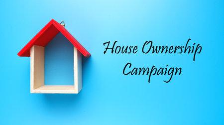 Photo pour A picture house miniature with houseownership campaign on blue background. - image libre de droit