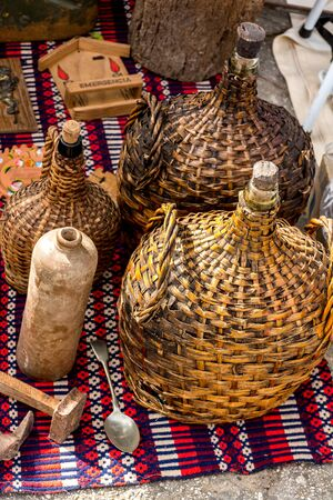 Variety of antique treasure items at Portugal market - pirates equipment, weapons, wine bottles,