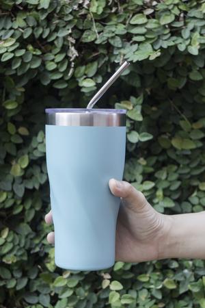 Foto de Stainless steel straw and mugs for reusable set, stock photo - Imagen libre de derechos