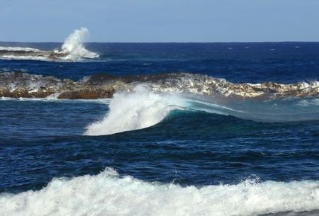 Three levels of white water are illustrated in this deep aqua expanse of the Kapoho Coast.  The first is the sky high crash of water against rocky point, the second is the cresting curl and the third ends as foamy rushing wave as it hits the shoreline.