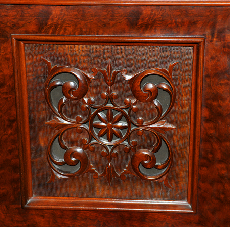 Elegantly carved panel is from an old antique, upright piano.  Wood is a deep red in color.