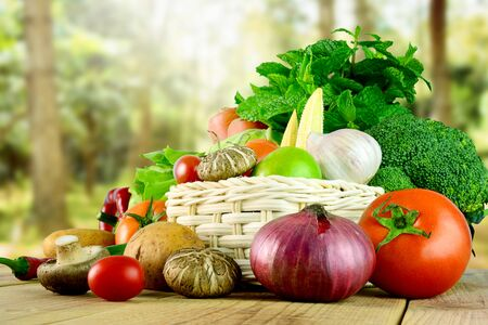 Photo for Fresh vegetables on wooden and blurred garden background. - Royalty Free Image