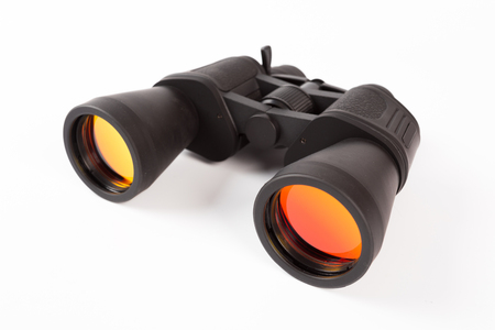 Foto de Black binoculars with orange lens isolated on white background - Imagen libre de derechos