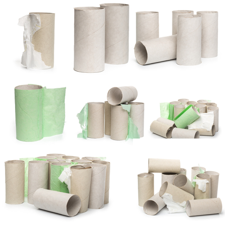 A selection of cardboard toilet paper tubes in various arrangements isolated on a white background. Large photograph, high resolution
