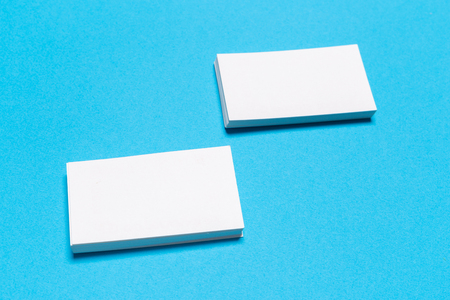 Photo for Blank white business cards on blue background. Mockup for branding identity. Template for graphic designers portfolios. Top view. - Royalty Free Image