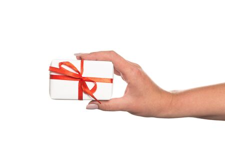 Photo pour Hands holding beautiful gift box, female giving gift, Christmas holidays and greeting season concept - image libre de droit